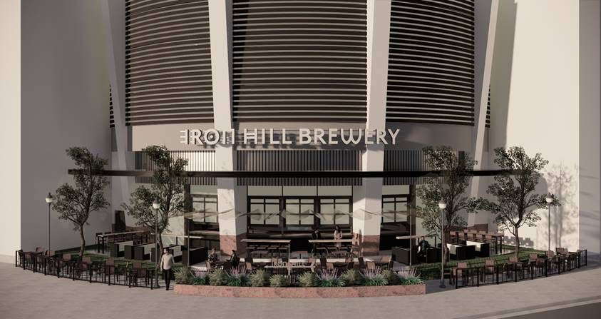A rendering of the exterior of Iron Hill Brewery with a large outdoor patio out front in Atlanta
