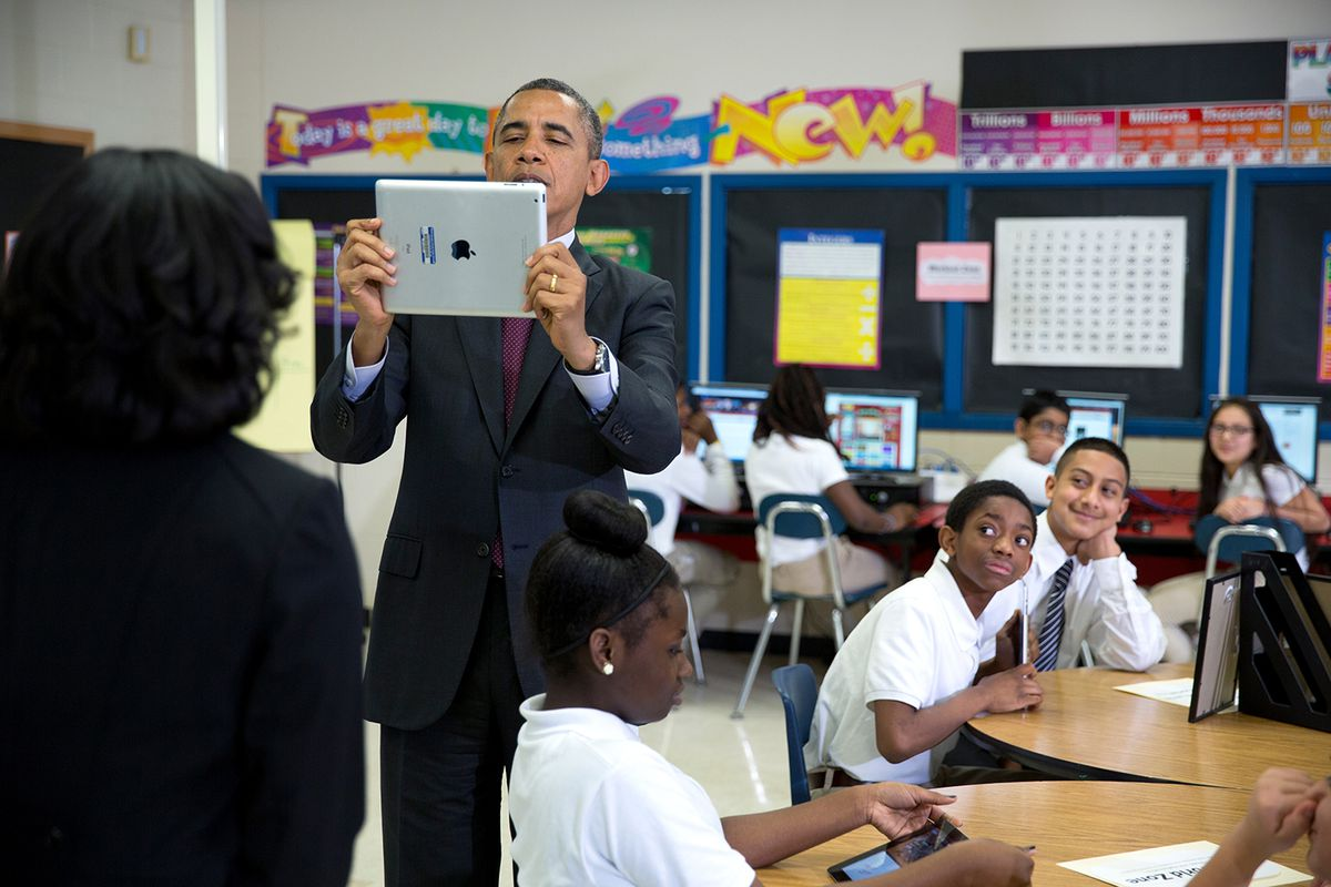 President Barack Obama using an iPad while visiting a classroom in Maryland in February.