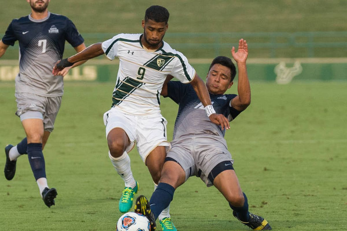 USF's Nazeem Bartman, shown here fighting off a clearly weak challenge to maintain possession.