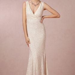 """<a href=""""http://www.bhldn.com/shop-the-bride-wedding-dresses/candence-gown/productoptionids/fbcaeb8b-b90b-4e9a-9313-32da085940dd"""">Candence Gown</a>, $1,950"""