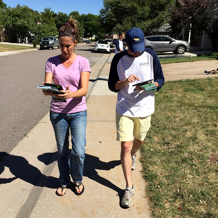 Americans For Prosperity-Colorado volunteer Kim Gilmartin, left, and AFP field director Alex Bolton, knocked on doors in a Littleton neighborhood Sept. 19 asking voters for their opinion on the school board majority's policies including school choice.