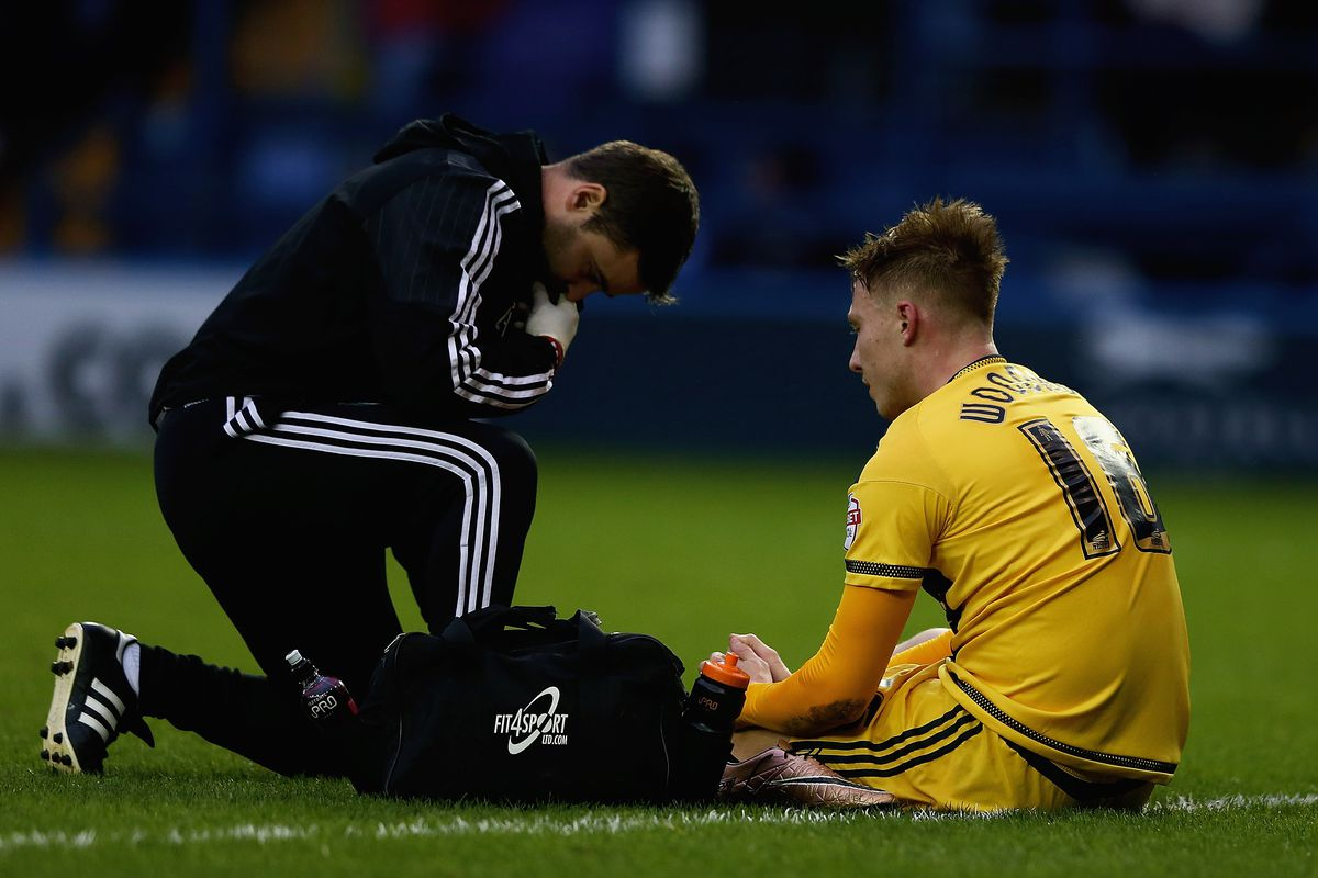 Cauley Woodrow receiving treatment from the trainer