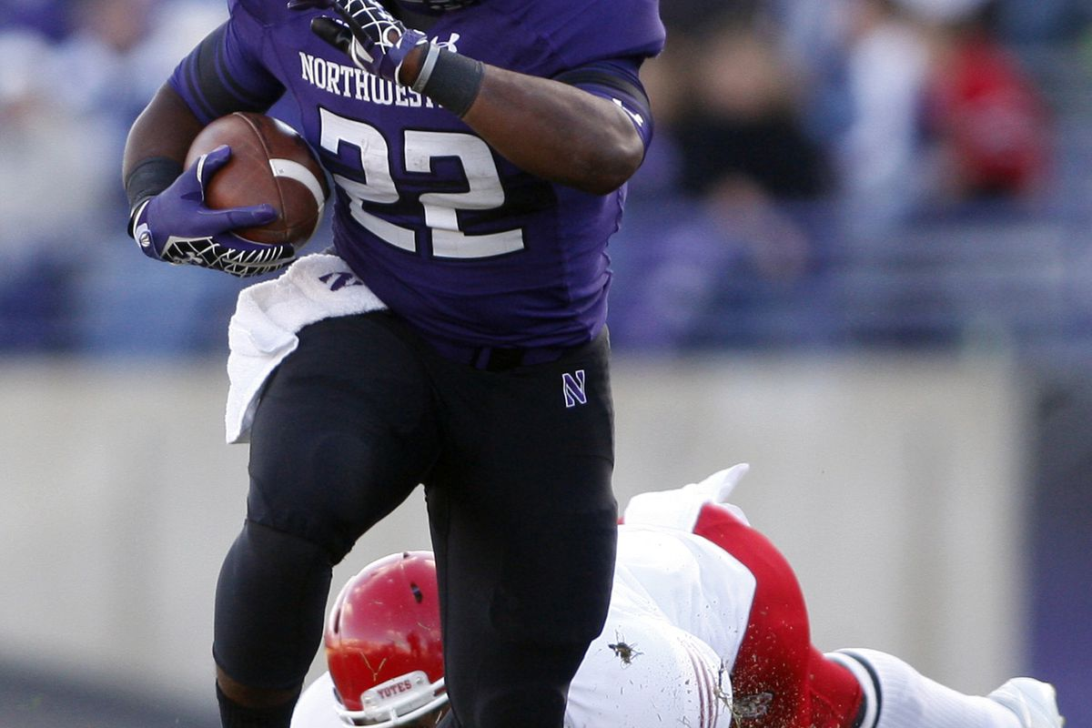 Sep 22, 2012; Evanston, IL, USA; Northwestern Wildcats running back Treyvon Green (22) during the fourth quarter against the South Dakota Coyotes at Ryan Field.  Mandatory Credit: Jerry Lai-US PRESSWIRE
