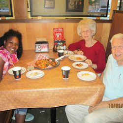Olivia Anderson goes out to eat with her grandparents Rosalin and Carl Anderson.