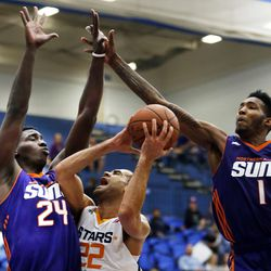 Salt Lake City Stars forward JJ O'Brien (22) is fouled by Northern Arizona Suns forward Johnny O'Bryant III (24) during NBA D-League Basketball in Salt Lake City on Friday, Nov. 18, 2016. Northern Arizona Suns forward Derrick Jones, Jr. (1) is at right.