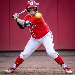 Utah catcher Kelly Martinez (22) keeps her eye on the ball as the University of Utah hosts Brigham Young University at Duke Stadium in Salt Lake City on Wednesday, April 18, 2018.
