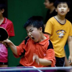 FILE - In this July 4, 2007 file photo, young ping pong students train at Beijing's Shichahai Sports School in Beijing, China.  China owns table tennis like the United States once dominated men's basketball.  Much of China's success is due to its systematic, Soviet-style approach of recruiting promising 5- or 6-year-olds to sports schools and then ruthlessly winnowing the field for the national team.