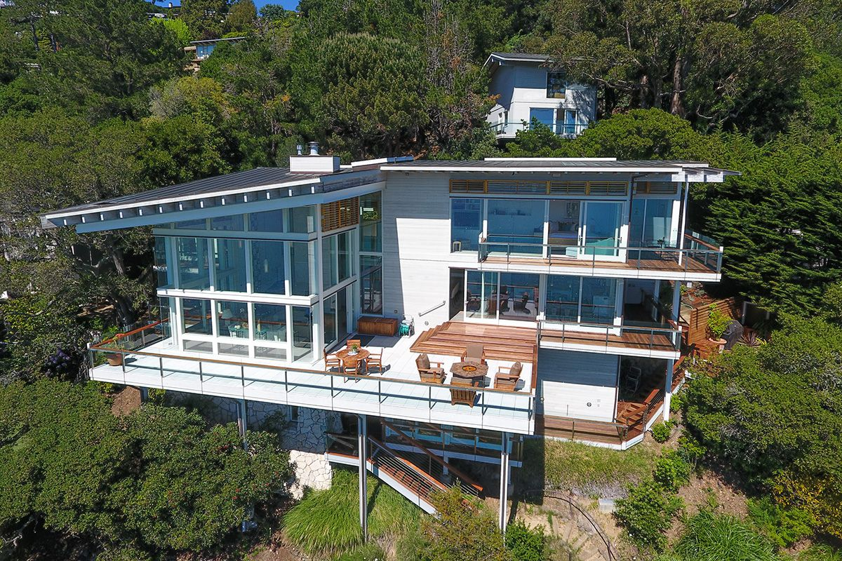 Three-story glass and steel home on a cliff in Belvedere. Dream house to the max!
