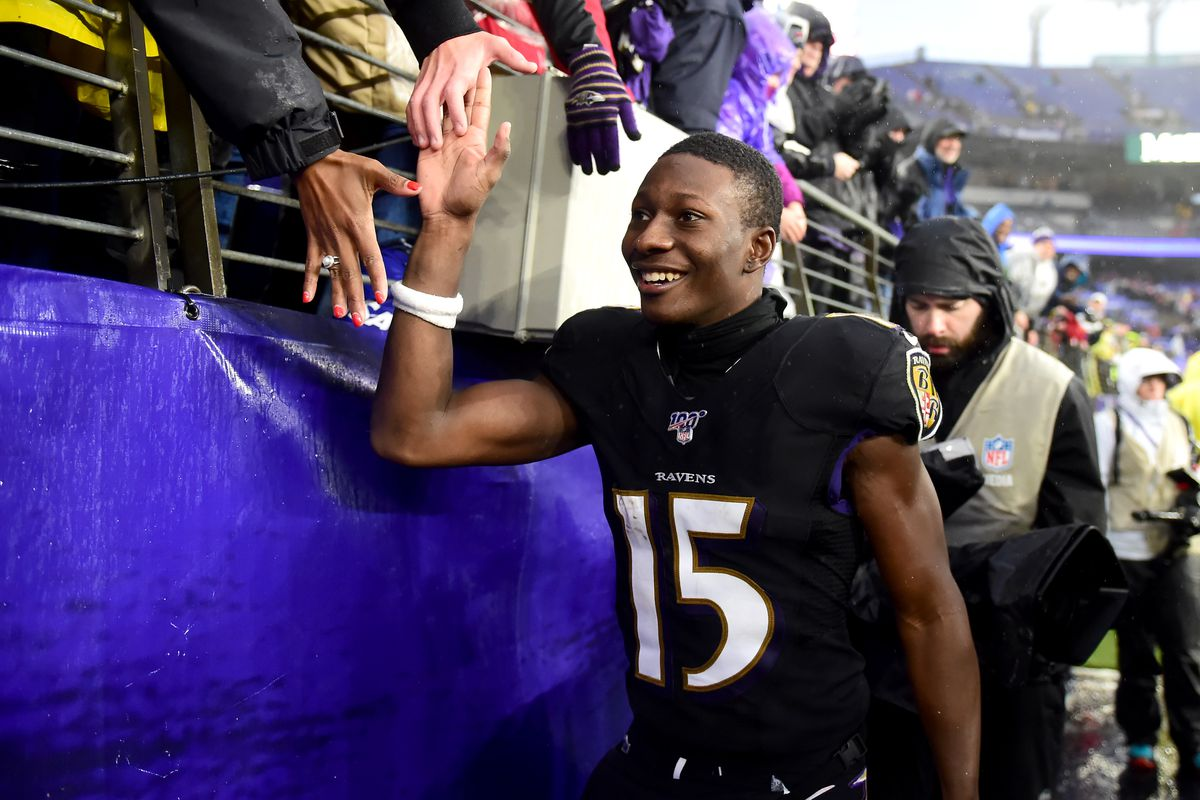 Baltimore Ravens wide receiver Marquise Brown high fives fans after beating the San Francisco 49ers 20-17 at M&T Bank Stadium.