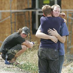 Friends of four hikers hug after hearing of the deaths. Some of the hikers had previously been inside the cave.