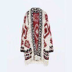 "<strong>Zara</strong> Fringed Ethnic Poncho, <a href=""http://www.zara.com/us/en/woman/knitwear/fringed-ethnic-poncho-c269190p2363501.html"">$99.90</a>"