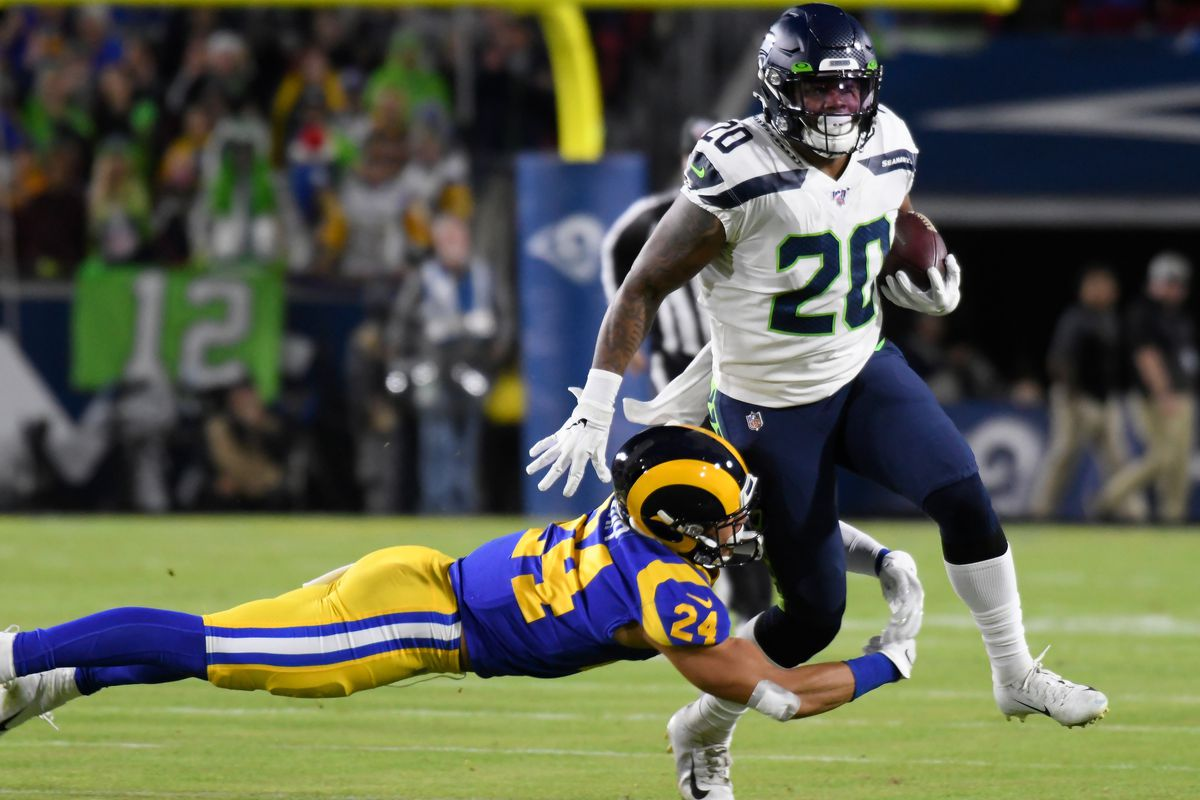 Los Angeles Rams safety Taylor Rapp makes a diving tackle on Seattle Seahawks running back Rashaad Penny in the first quarter at Los Angeles Memorial Coliseum.