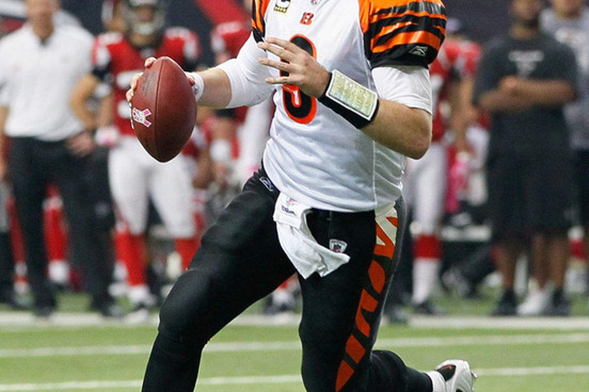 ATLANTA - OCTOBER 24:  Quarterback Carson Palmer #9 of the Cincinnati Bengals rushes out of the pocket against the Atlanta Falcons at Georgia Dome on October 24 2010 in Atlanta Georgia.  (Photo by Kevin C. Cox/Getty Images)