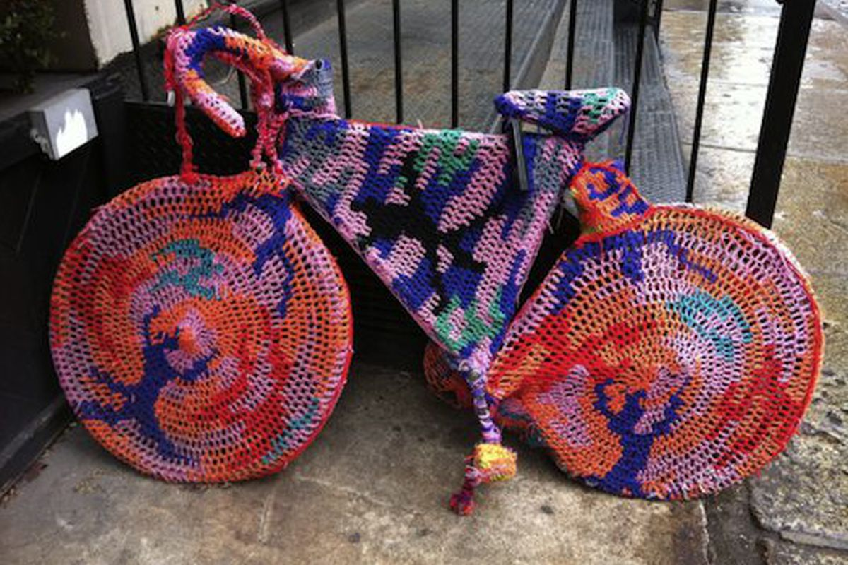 "Yarn bike outside Acne Studios, via <a href=""http://twitpic.com/4mxij2"">@peterdavisnyc</a>"