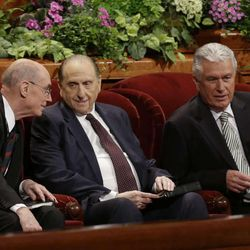 President Thomas S. Monson, center, and his two counselors, Henry B. Eyring, left, and Dieter F. Uchtdorf, right, talk during the 183rd Annual General Conference of The Church of Jesus Christ of Latter-day Saints Saturday, April 6, 2013, in Salt Lake City. Saturday, April 6, 2013, in Salt Lake City. The Mormon church is planning to build two new temples in Rio de Janeiro and Cedar City, Utah. The faith's president, Thomas S. Monson, announced the new temples on Saturday during the 183rd semi-annual general conference of The Church of Jesus Christ of Latter-day Saints. More than 100,000 members of the church have gathered in Salt Lake City to hear words of inspiration and guidance for daily living from the faith's senior leaders.  (AP Photo/Rick Bowmer)