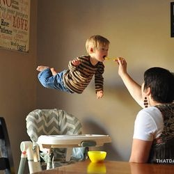 """Sheri Lawrence feeds her son William. Alan Lawrence photographed William in a series titled """"Wil Can Fly"""" on his blog, <a href=""""http://thatdadblog.com/"""">thatdadblog.com</a>"""