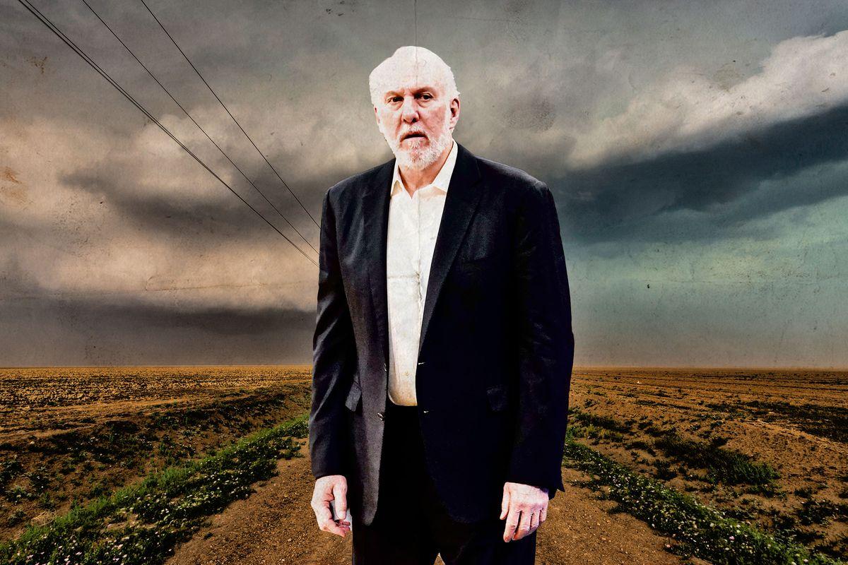 San Antonio Spurs head coach Gregg Popovich standing in a barren field