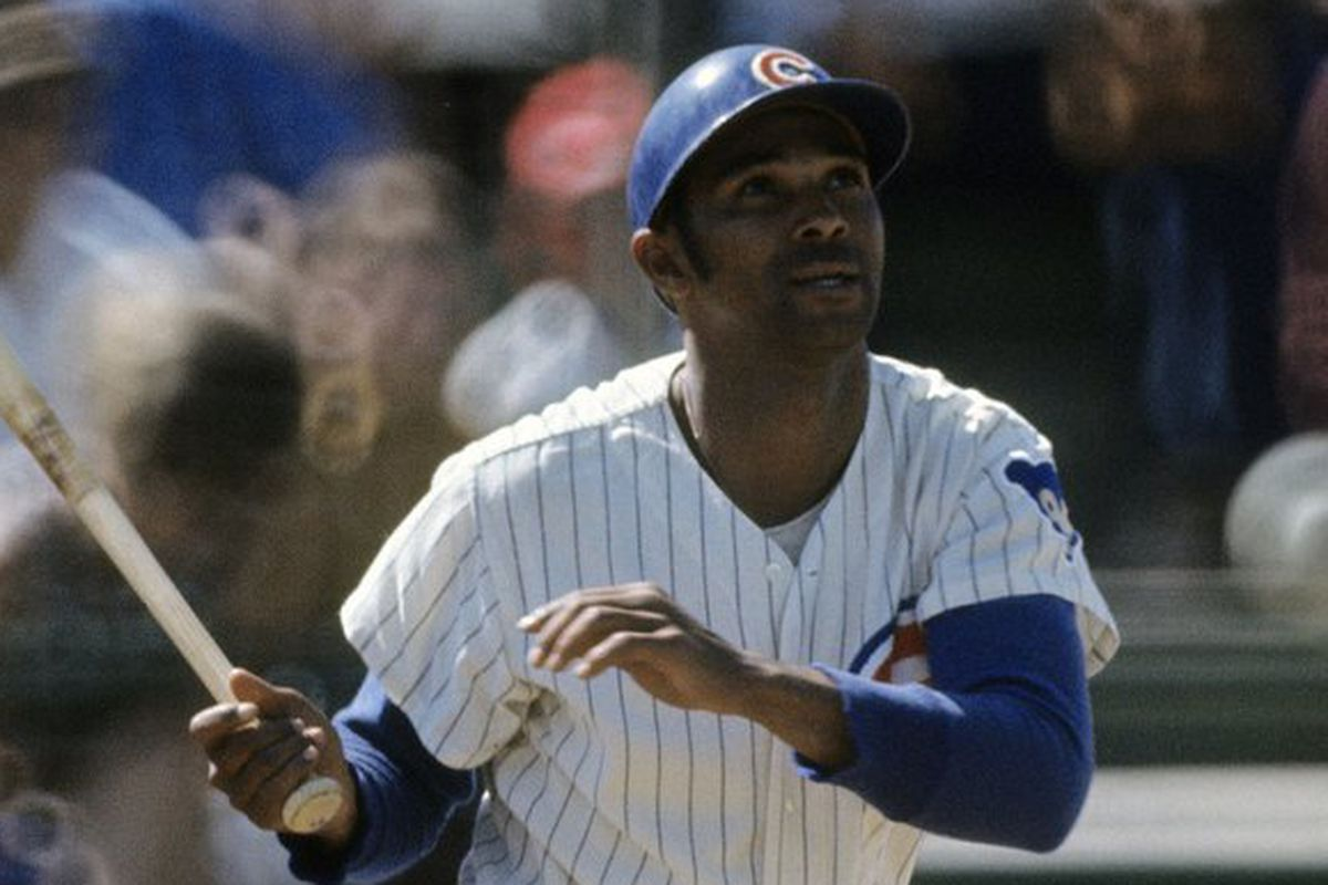 First baseman Billy Williams of the Chicago Cubs swings and watches the flight of his ball during a Major League Baseball game. Williams played for the Cubs from 1959-74