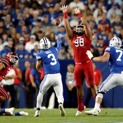 Utah Utes defensive tackle Viane Moala (98) tries to knock down a pass by Brigham Young Cougars quarterback Jaren Hall (3) during an NCAA football game at LaVell Edwards Stadium in Provo on Saturday, Sept. 11, 2021.