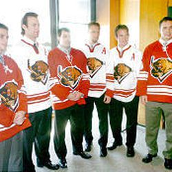 Grizzlies hockey players, from left to right, Sheldon Keefe, Rick Berry, Jon Sim, Martin Sonnenberg, Erik Westrum and Doug Doull, wear Utah's new home and away jerseys at the annual Face-Off luncheon. The Grizzlies open the season Wednesday in West Valley against Cincinnati.
