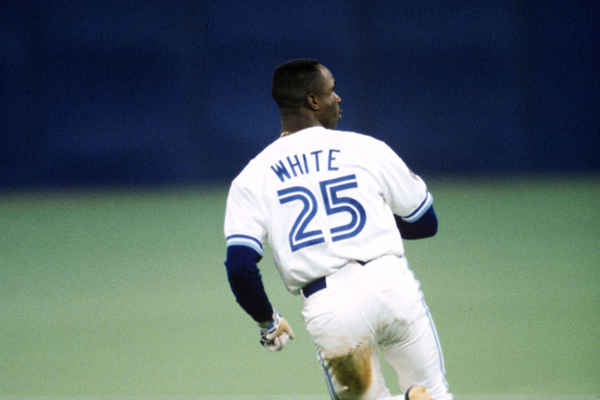 Outfielder Devon White #25 of the Toronto Blue Jays heads to second base during Game Four of the 1992 World Series against the Atlanta Braves