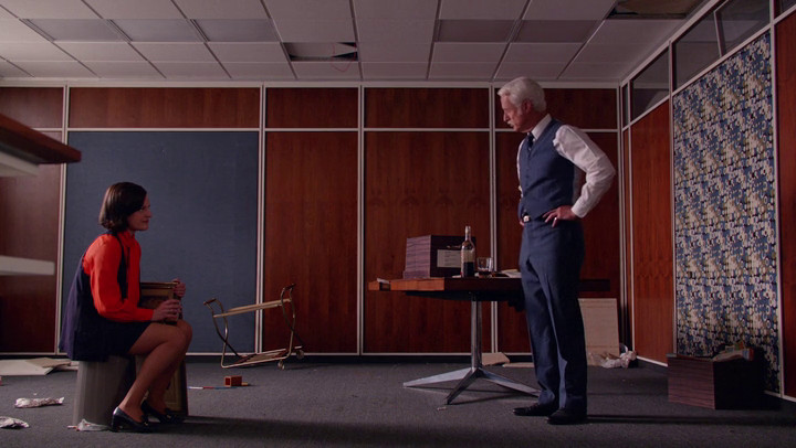 Roger and Peggy have a drink on Mad Men.