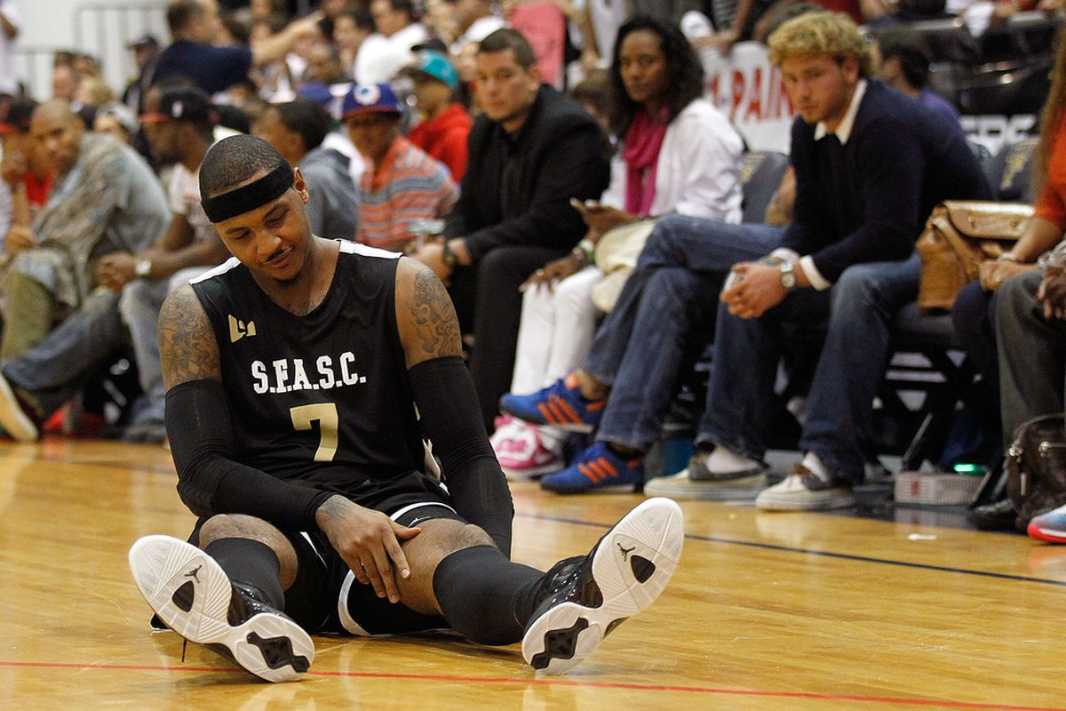 MIAMI, FL - OCTOBER 08: Carmelo Anthony reacts to a leg cramp during the South Florida All Star Classic at Florida International University on October 8, 2011 in Miami, Florida.  (Photo by Mike Ehrmann/Getty Images)