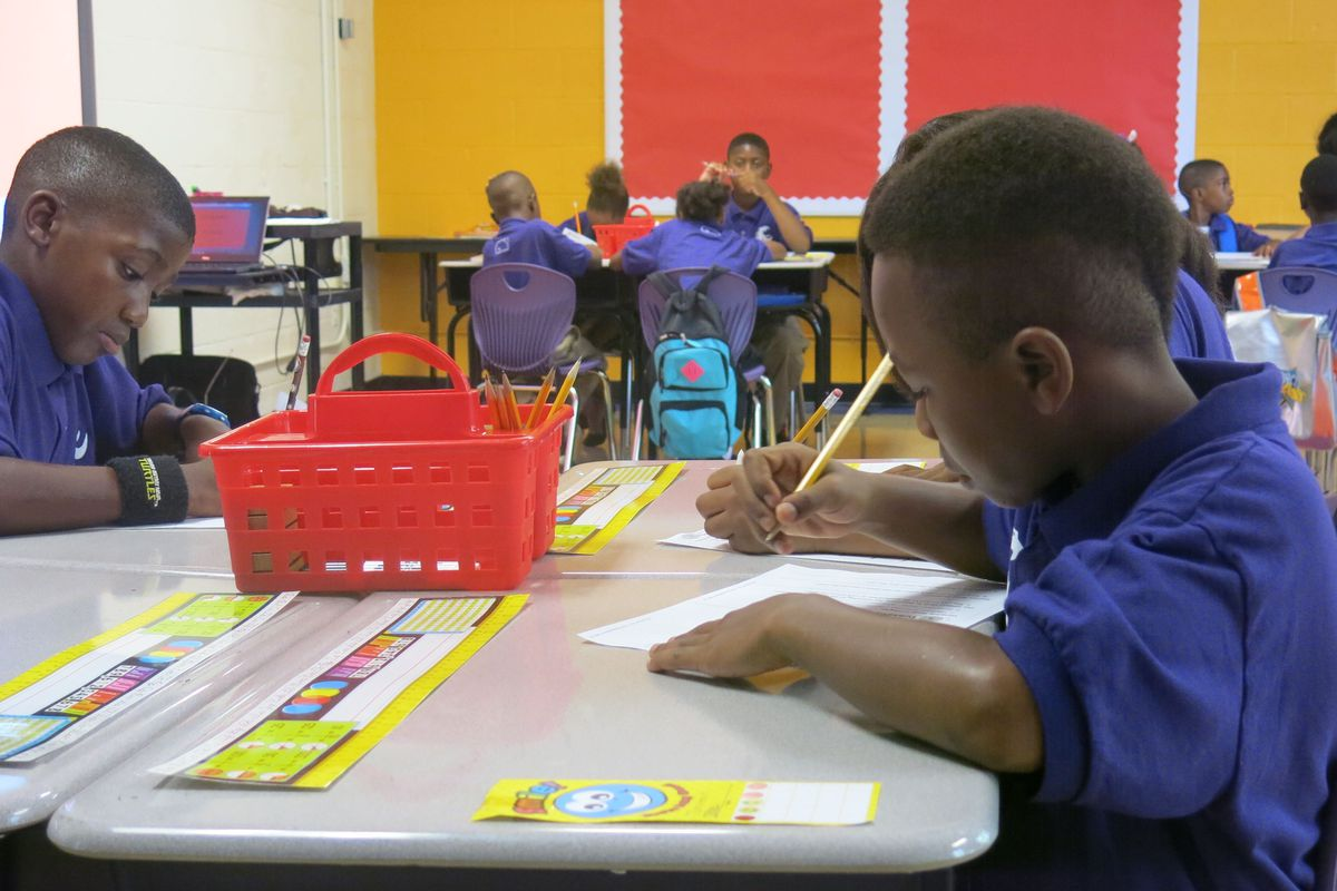 Jonathon Verry and Trumaine Gholson in a math class at Aspire's new school at Coleman Elementary.