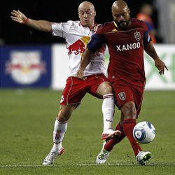RSL's Robbie Russell fights for the ball with New York's Luke Rodgers. RSL scored three goals in 21 minutes.
