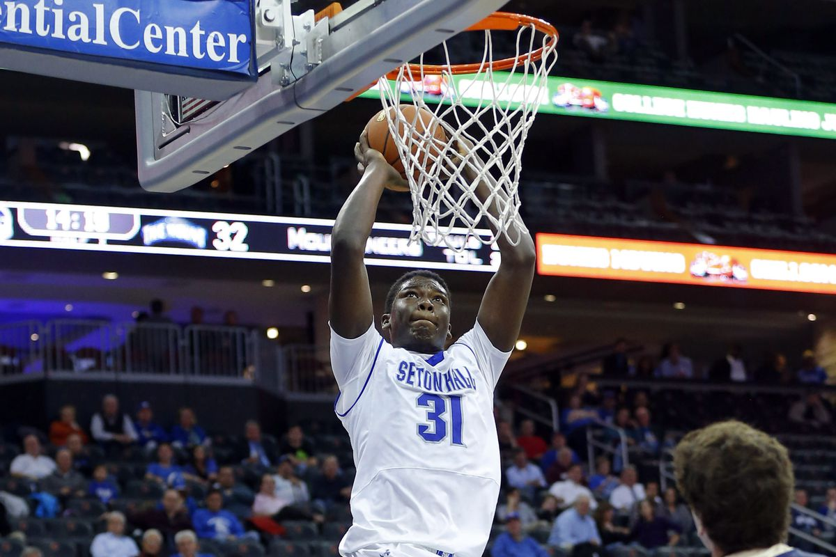 Angel Delgado dunks for two of his 13 points. The freshman also collected 9 rebounds.