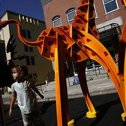 Maya Drayton, 4, of Park City, explores some animal sculptures at the Park City Arts Festival on Main Street on Friday.