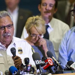 Chief Dan Fraijo,left, speaks as  Gov. Jan Brewer wipes away a tear during press conference at Prescott High School, Monday July 1, 2013, talking about the tragedy that took the lives of 19 members of the Granite Mountain Hot Shot crew, Sunday. (AP Photo/The Arizona Republic, Tom Tingle)