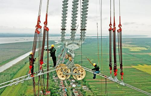 Chinese workers building a UHV line across the Yangtze River.