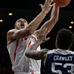 Arizona's Chase Jeter, center, loses the ball attempting the layup during the Arizona-Georgia Southern game in McKale Center on November 29 in Tucson, Ariz.