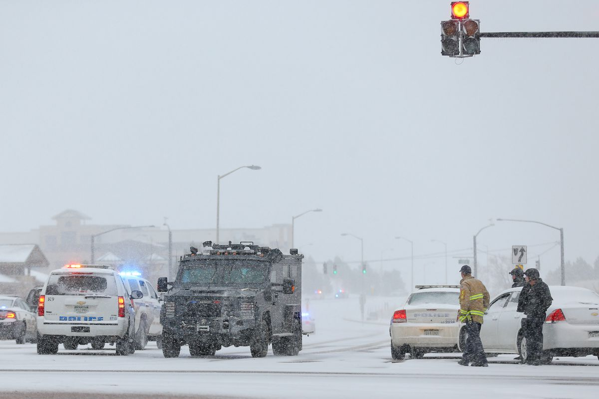 An armored police vehicle transports hostages out of the area of the Planned Parenthood shooting.