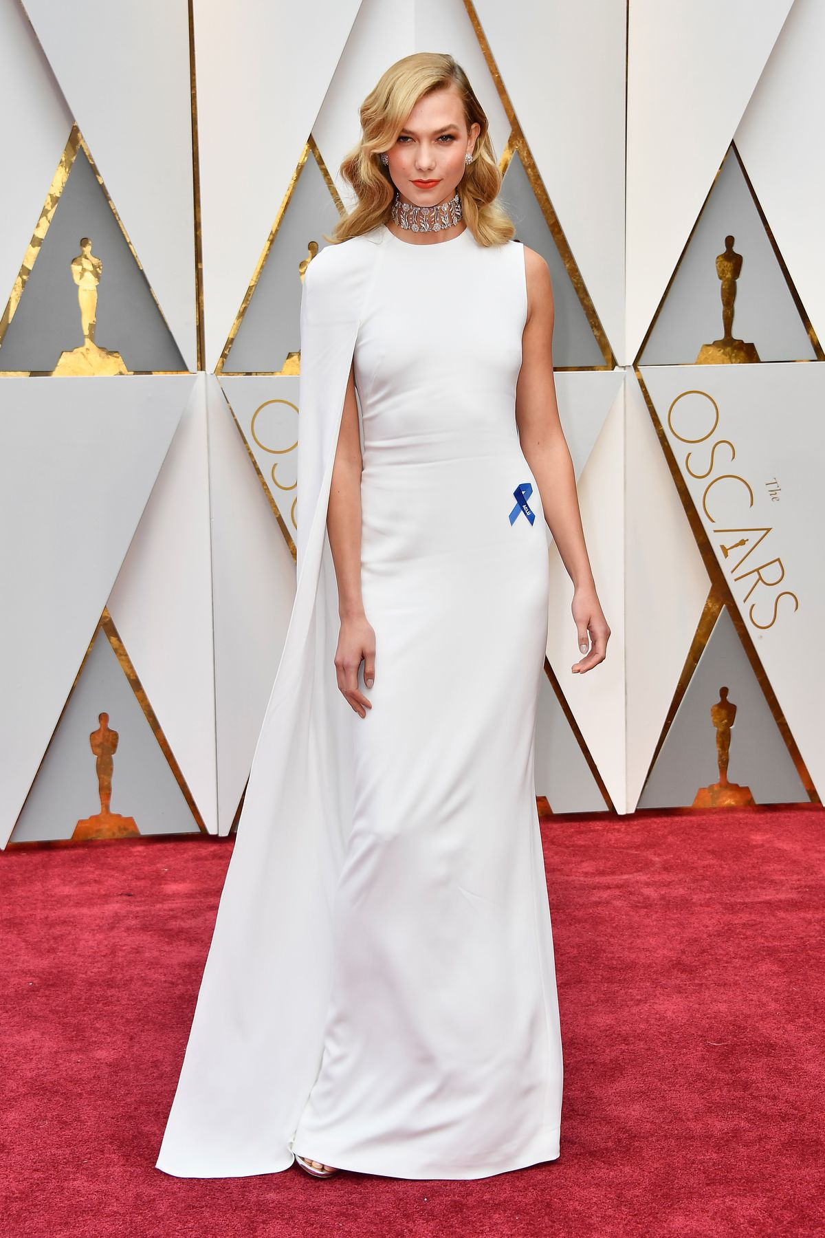 Karlie Kloss with a blue ribbon on the Oscars red carpet