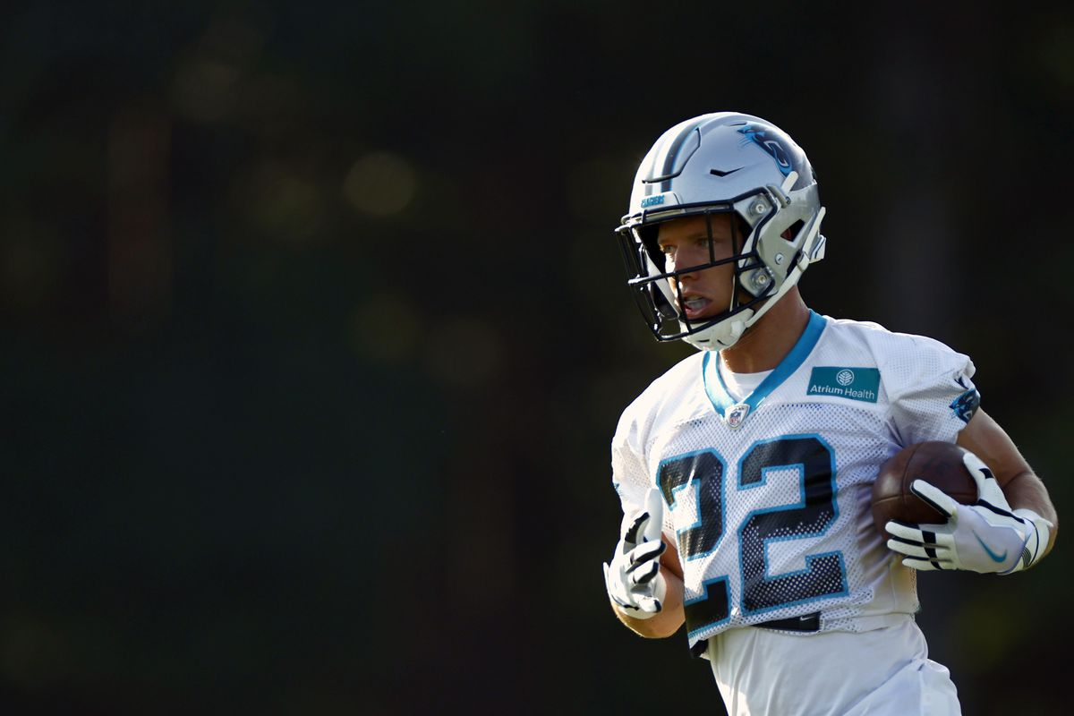 Christian McCaffrey #22 of the Carolina Panthers carries the ball during Panthers Training Camp at Wofford College on July 28, 2021 in Spartanburg, South Carolina.