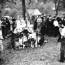 Thirteen-year-old David Mace officiated as Spencer grade school children burned 2,000 comic books they have been collecting for weeks in Spencer, West Virginia , on Oct. 26, 1948. The campaign was initiated by the parent-teacher association on the ground the books are mentally and morally injurious to boys and girls. (AP Photo)