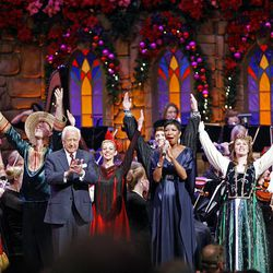 Singer Natalie Cole and author David McCullough applaud at the end of the Christmas concert at the Conference Center Friday in Salt Lake.