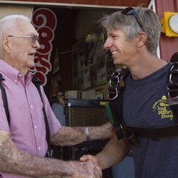 Wendell Ashcroft, left, and Scotty Freeland introduce themselves to each other at Skydive Ogden in Ogden on Saturday, Aug. 5, 2017. Freeland served as Ashcroft's tandem instructor and they were connected through the entire jump.