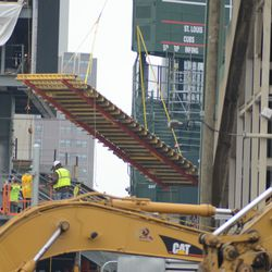 12:32 p.m. View from Waveland and Clark, of form being lowered into the left field bleachers -