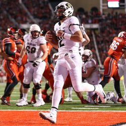 Colorado Buffaloes quarterback Steven Montez (12) runs the ball for a touchdown, making the score 31-13 Utes, at Rice-Eccles Stadium in Salt Lake City on Saturday, Nov. 25, 2017.