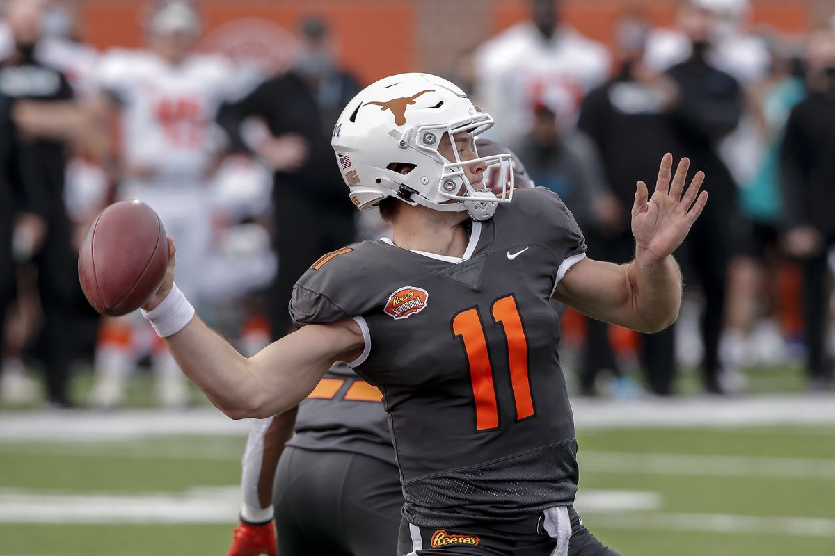 Quarterback Sam Ehlinger #11 from Texas of the National Team on a pass play during the 2021 Resse's Senior Bowl at Hancock Whitney Stadium on the campus of the University of South Alabama on January 30, 2021 in Mobile, Alabama. The National Team defeated the American Team 27-24.