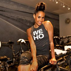 """<a href=""""http://la.racked.com/archives/2014/08/15/hottest_trainer_contestant_10_angela_davis.php""""><b>Angela Davis</b></a> of SoulCycle"""