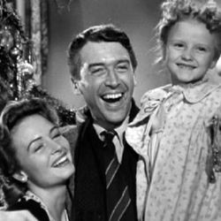 """Donna Reed, left, James Stewart and young Karolyn Grimes in the 1946 original, """"It's a Wonderful Life."""""""