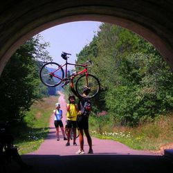 This July 29, 2011 photo shows cyclists celebrating at the Eastern Continental Divide before the long and bracing downhill to Cumberland, Md., on the Great Allegheny Passage. The passage is a 141-mile rail-trail from Homestead, Pa., near Pittsburgh, to Cumberland in Western Maryland.