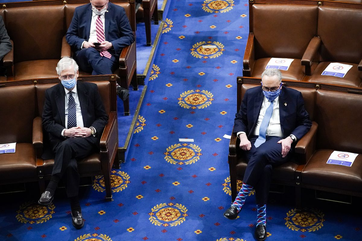 Senate Majority Leader Mitch McConnell and Senate Minority Leader Chuck Schumer in the House Chamber during a reconvening of a joint session of Congress on January 6.  Drew Angerer/Getty Images