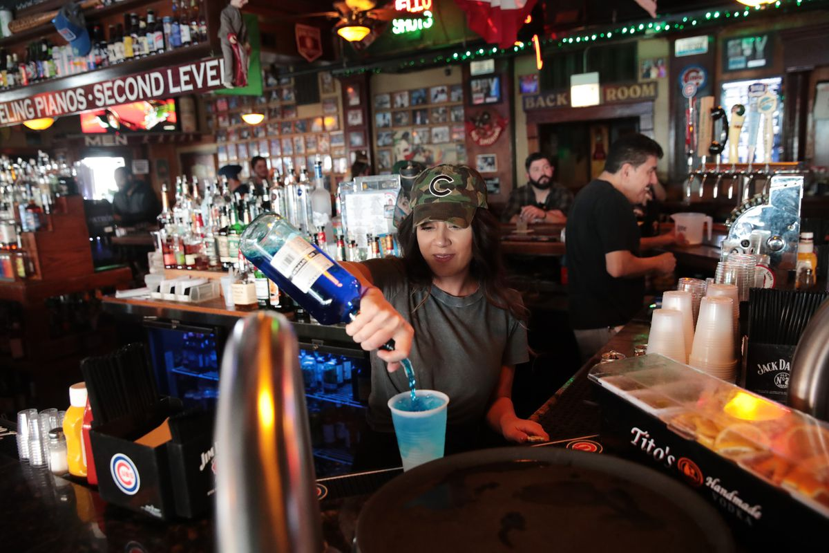 Bartender Ming Ling waits on customers at Sluggers, a family-owned sports bar and grill in the shadow of Wrigley Field, on March 15, 2020.