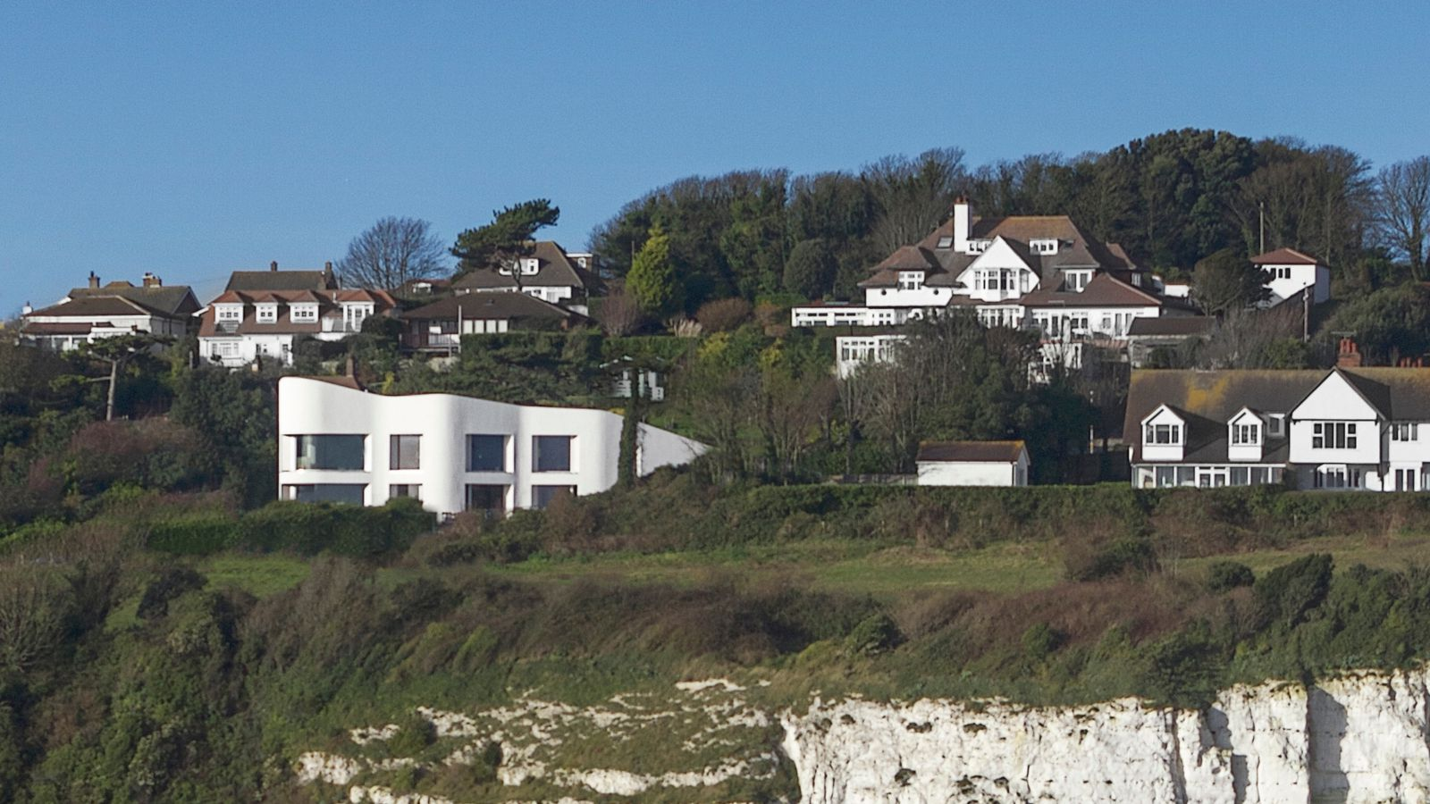 Undulating modern home graces the White Cliffs of Dover ...