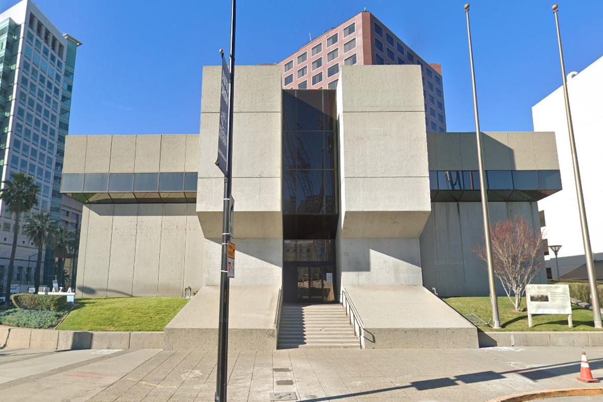 A big, squat, geometrically-shaped concrete building.